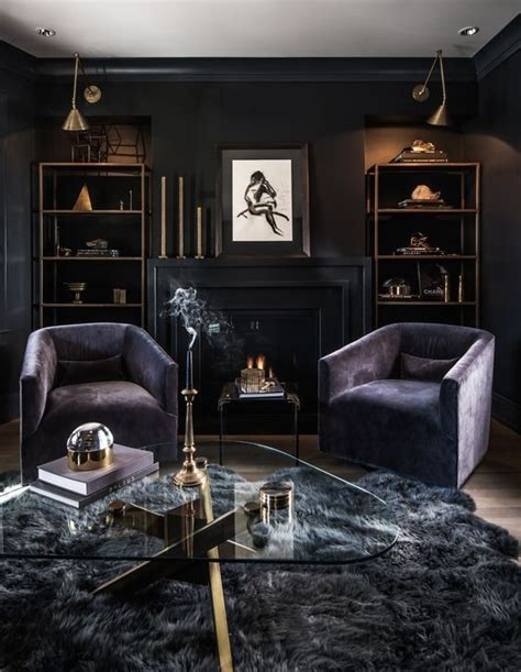 a luxurious dark living room with black walls, purple